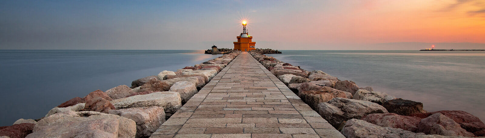 stone pier with lighthouse at the end